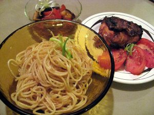 Garlic Noodles with yakitori thigh, tomatoes, and eggplant tomato salad.
