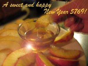 Rosh Hashonah dipping apples in honey