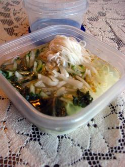 Korean summer noodles with pickled radishes and cucumbers