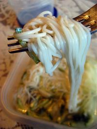 eating Korean noodles with a fork