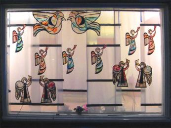 faux stained glass Christmas decorations made with tissue paper and glue