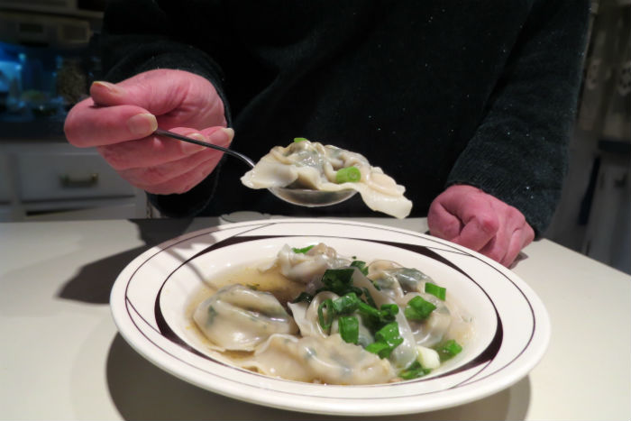 eating lamb wontons_6484